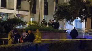 Police investigate a shooting outside the Strozier library on the Florida State University campus in Tallahassee (AP)