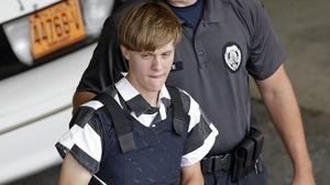 Dylann Roof is escorted from the Cleveland County Courthouse (AP)