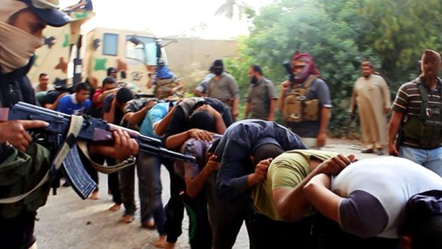 This image posted on a militant website last year appears to show militants from the al-Qaida-inspired Islamic State of Iraq and the Levant (ISIL) leading away captured Iraqi soldiers dressed in plain clothes after taking over a base in Tikrit, Iraq.