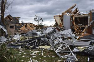 In Chattanooga, Tennessee, at least 150 homes and commercial buildings were damaged (Robin Rudd/Chattanooga Times Free Press via AP)