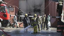 Afghan firefighters spray water near a guest house targeted in an attack by the Taliban, in Kabul (AP)