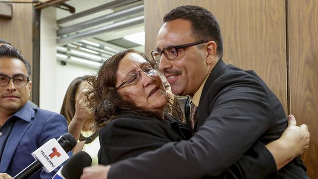 Marco Contreras, 41, right, is hugged by his mother, Maria Contreras (AP Photo/Damian Dovarganes)