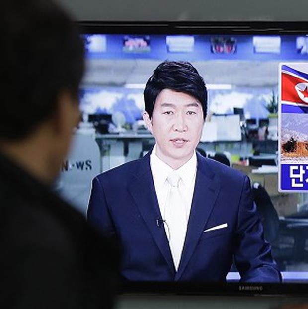 A South Korean man watches a TV bulletin reporting North Korea's missile launch in Seoul (AP)
