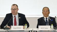 Toshiro Muto and Craig Spence at a meeting in Tokyo about the Olympics (Kyodo News via AP)