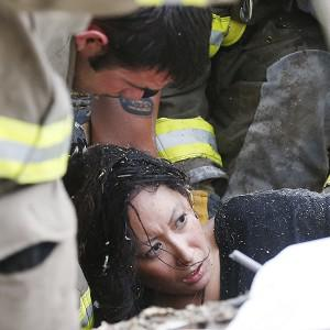 A woman is pulled out from under tornado debris at the Plaza Towers School in Moore, Oklahoma (AP/Sue Ogrocki)
