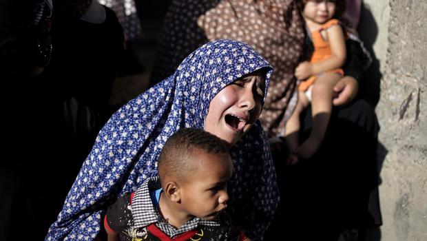 A Palestinian relative of four boys from the same extended family grieves during their funeral. (AP)