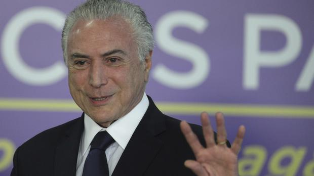 Michel Temer faces a congressional vote on his future (AP Photo/Eraldo Peres)