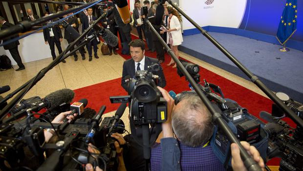 Italian prime minister Matteo Renzi speaks with the media after the EU summit in Brussels (AP)