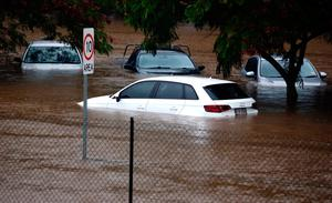 Cars under flood waters outside the Robina Hospital after torrential rain on Australia's Gold Coast. Photo: AFP/Getty Images