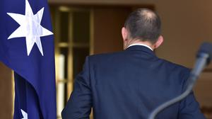 Outgoing Australian prime minister Tony Abbott walks away from the lectern after speaking at a press conference in Canberra (AP)