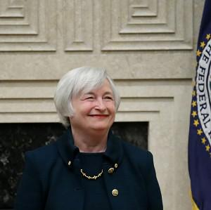 Janet Yellen smiles before being sworn in as Federal Reserve chairwoman (AP Photo/Charles Dharapak)