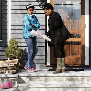 Neighbours lay flowers at the house of the 8-year-old victim (AP)