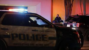 San Antonio police stand guard at the Rolling Oaks Mall after a fatal shooting on Sunday (AP Photo/Eric Gay)