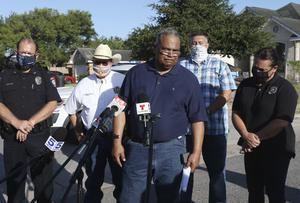 McAllen Police Chief Victor Rodriguez (centre) speaks to reporters near the scene where two of his officers were shot dead (Delcia Lopez/The Monitor/PA)