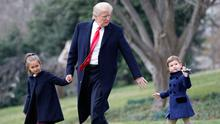 President Donald Trump walks with his grandchildren, Arabella and Joseph Kushner, at the White House yesterday. Photo: AP