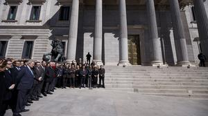 Members of the Spanish parliament hold a minute of silence in Madrid (AP)