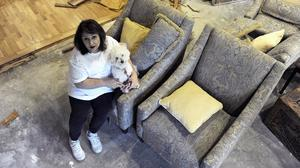 Randi Rosenkrantz holds her dog Sugar as she talks about the flood damage to her home in Houston (AP)
