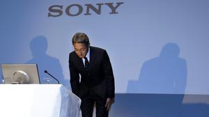 Sony president Kazuo Hirai bows at the end of a press conference at the company's headquarters in Tokyo (AP)