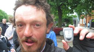 Mike Hall with his pedometer at Greenwich Royal Observatory in south-east London in 2012 after he won a round-the-world bike race