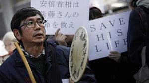 Demonstrators demand the release of Japanese journalist Kenji Goto in a rally outside the prime minister's residence in Tokyo (AP)