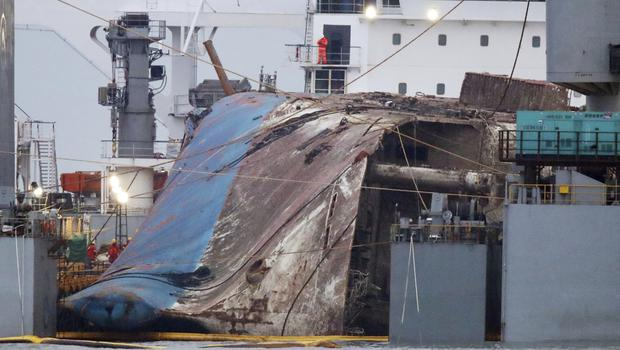 The Sewol ferry is loaded on to a semi-submersible transport vessel during the salvage operation (Yonhap/AP)
