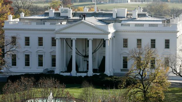 A man who was carrying a package near the White House and made suspicious comments to an officer has been taken into custody.