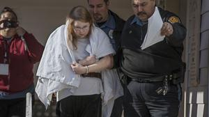 Sara Packer, the adoptive mother of Grace Packer, is led out of court in handcuffs and taken into custody (Michael Bryant/The Philadelphia Inquirer/AP)