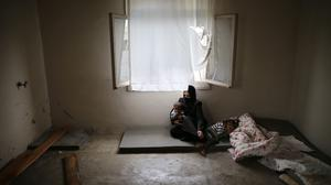 Syrian refugee Hind Salem, who fled with her family from Palmyra because of Russian air strikes (AP)