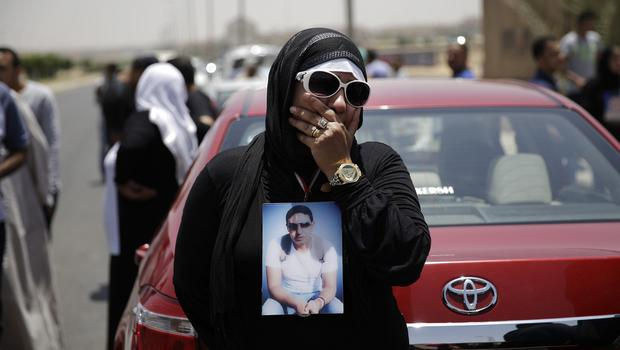 A mother of a supporter of the Al-Ahly club awaits the verdict against 11 people for their role in a deadly 2012 soccer riot. (AP)