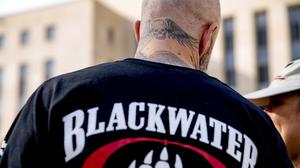 A former member of Blackwater joins family members, friends and supporters of four former Blackwater security guards outside the federal court in Washington (AP)