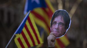 Mr Puigdemont said he will never give up (AP)