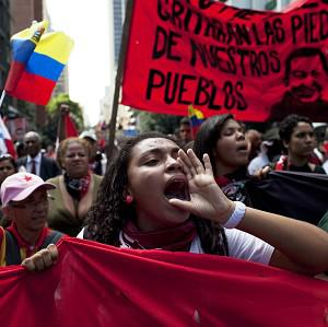 "Members of a pro-government ""colectivo,"" or ""collective,"" march in Caracas (AP)"
