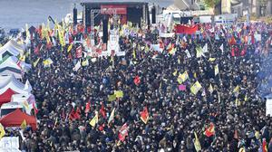 Pro-Kurdish demonstrators protest against Turkish president Recep Tayyip Erdogan and the political repression that followed July's failed military coup, in Cologne (AP)