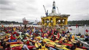 Activists who oppose Royal Dutch Shell's plans to drill for oil in the Arctic Ocean prepare their kayaks for the Paddle in Seattle protest (Daniella Beccaria/seattlepi.com via AP)