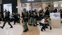 Stand-off: Riot police fire pepper rounds inside a shopping mall during a protest in Hong Kong. Photo: Tyrone Siu/Reuters
