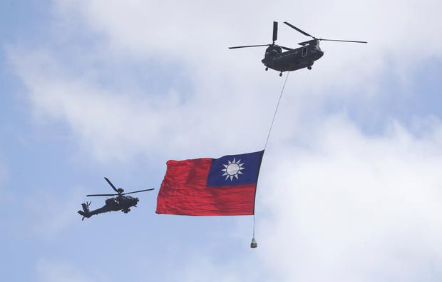 Helicopters fly over the Presidential Office Building in Taipei during National Day celebrations (Chiang Ying-ying/AP)