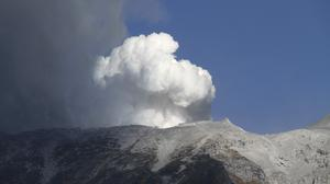 Plumes of smoke and ash billow from Mount Ontake as it continues to erupt in Otaki village in Nagano prefecture, Japan (AP)