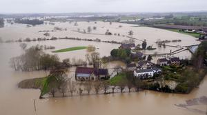 Flooding in Worcestershire in February (PA)