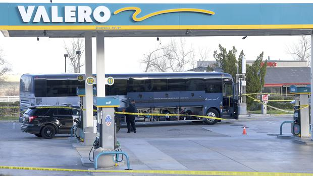 Investigators near a Greyhound bus after a passenger was killed on board in Lebec, California (Jayne Kamin-Oncea/AP)