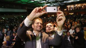 The opposition Ordinary People and Independent Personalities party, whose leader Igor Matovic is shown snapping a selfie with a supporter, is leading the vote in Slovakia's election (Petr David Josek/AP)