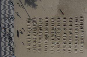 Activists dig symbolic graves on Copacabana beach as a protest against the government's handling of the pandemic (Leo Correa/AP)