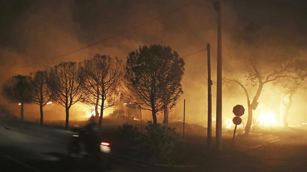 Buildings burn in the town of Mati, east of Athens (Thanassis Stavrakis/AP)