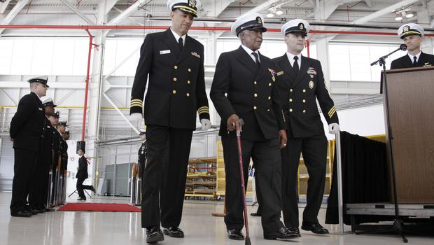 Carl Clark, centre, during a special presentation ceremony at Moffett Field in Mountain View, California (AP)