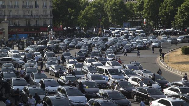 Taxis gather at a major entrance of Paris (AP)