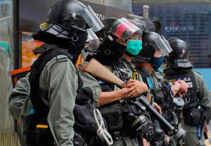 On guard: Hong Kong riot police at Central during the second day of debate on the Chinese bill. Photo: AP Photo/Vincent Yu