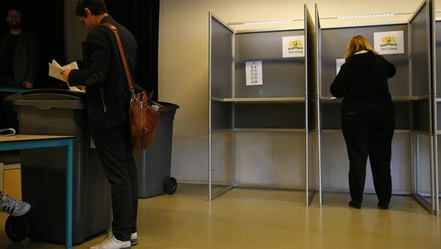 People cast their ballots as they vote in the Dutch general election (AP/Peter Dejong)