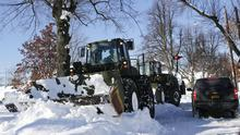 National Guard vehicles clear snow from a street in the south Buffalo area (AP)