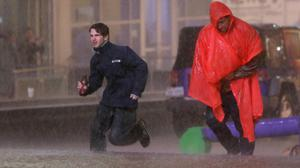 People run as weather sirens sound as a severe storm passes over central Dallas (AP)