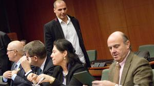 Greek finance minister Yanis Varoufakis, standing, during a meeting of eurozone finance ministers in Brussels (AP)