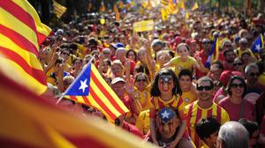 People wave estelada flags, that symbolize Catalonia's independence, during a demonstration calling for the independence of Catalonia in Barcelona (AP)